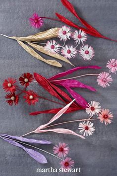 A single stem can feature multiple blooms, as shown here with these asters. The centers are cotton covered with glitter, the petals are created with fringing scissors, and the leaves are made from twisted ribbon paper. #marthastewart #crafts #diyideas #easycrafts #tutorials #hobby