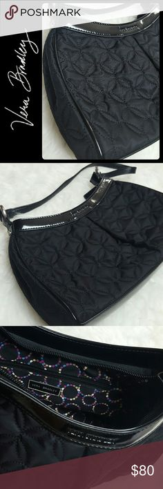 Vera Bradley Quilted Shoulder Bag Vera Bradley Signature Purse in Classic Black Quilted Style! Sturdy Built with Silver Tone Hardware! Zipper Top Closure Opens to Fully Lined Interior with Zipped and Slip Pockets! Features Vera Bradley Logo Print Embossed on Front! Excellent Used Condition! H7xW11xD2 inches Vera Bradley Bags