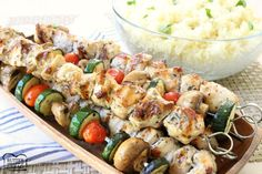 Simple recipe for Greek Chicken Souvlaki grilled to perfection & served with lemon rice. Perfect weeknight dinner with fresh, bright flavors of Greek food.