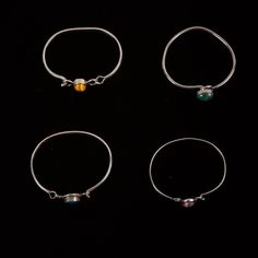 Collection of Sterling Silver Bangles with Stones