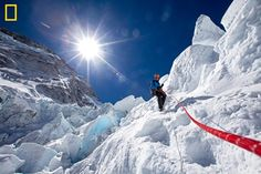 Conrad Anker descending an ice step in the Khumbu Icefall of Mount Everest with a fixed rope