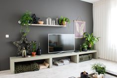 """""""Never be afraid to experiment with paint! After all, you can always repaint it if you don't like the result. However, if it does work out the payoff is huge."""" The wall paint behind the TV is Flexa."""