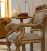 Paint chairs this color. A bit more blue-grey...Annie Sloan Paris Grey with Drak Wax and gilt highlights.