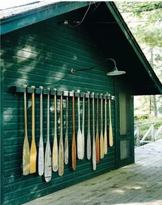 A collection of oars. Fun for the exterior of a cabin or boat house. Haus Am See, Boho Home, Lake Cabins, Lake Cottage, Cottage Homes, Seen, River House, Cabins In The Woods, Lake Life