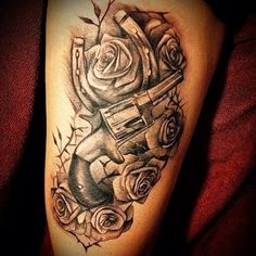 gun and flower tattoo  | black and gray roses with horse shoe and gun tattoo