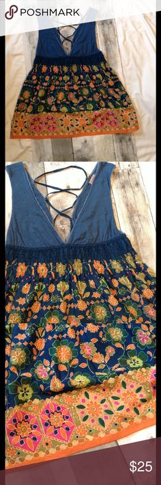 ☀🌞☀️️Sun Shine ☀️🌞☀️ Dainty and cutely Feminine Sleeveless low cut v-neck Sun top/dress from Free People in size 8. Shirt is dressed up in bright orange, pink, green geometric floral pattern with a lace up  tie back to adjust however your playful soul desires.  Elastic high waisted band sits right below breasts which helps give the perfect shape!   Gently used.  Smoke free & pet free home.  Steamed press. Free People Tops