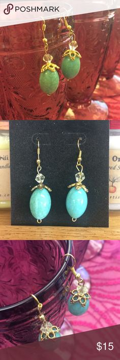 Turquoise Bead Earrings Gorgeous faux turquoise beaded earrings with gold accents and a clear cut bead for detail. Beautiful piece of costume jewelry that is sophisticated and lightweight. These earrings dangle and catch the light, showing off their green and blue marbling. Artisans Korner Jewelry Earrings