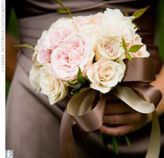 The bridesmaids held bouquets of Sahara roses, pink spray roses, vendela roses, and oceana roses with touches of red huck, all wrapped up with coordinating mocha ribbon.
