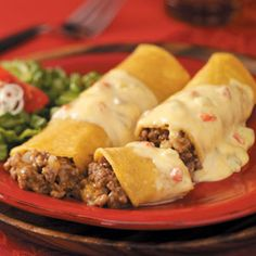 Delish! I also add a bit of enchilada sauce to the bottom of the pans to get soaked into the enchiladas as they cook!