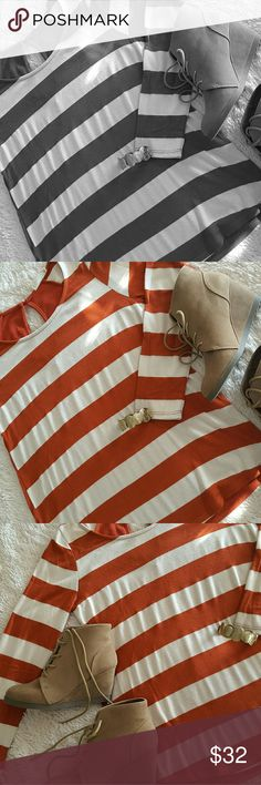 creamy white and orange wide striped knit sweater Very cozy and comfy lightweight sweater. Perfect with a pair of jeans, layered with a cardigan or even vest. Dress it up a little more with a stylish necklace and a pair of booties. Pull it all together for an effortless yet envious look! Runs a little big, if you normally wear a large, I think you can get away with this medium. I'm often between a medium and a large and this fits comfortably without feeling too big or too small. Sweaters