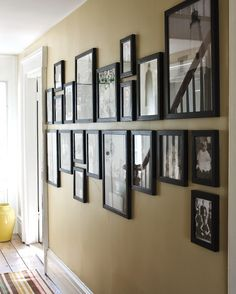 Give framed images a striking effect by hanging them above and below an invisible line. To unify the group, choose a single color for all frames and, if displaying photographs, stick with either all black-and-white or all color shots.