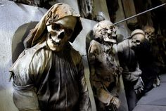 The Capuchin Catacombs of Palermo were constructed after the death of Silvestro of Gubbio, a famous 16th century monk. Four long limestone corridors underneath the Capuchin Church hold about 8,000 mummies, lying in repose or hung from hooks by their necks and feet and wearing their best clothes.