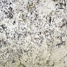 DELICATUS. Clusters of black and grey on an egg shell white background with hints of yellow gold. Gorgeous granite color available at Knoxville's Stone Interiors. Showroom located at 3900 Middlebrook Pike, Knoxville, TN. www.knoxstoneinte... FREE Estimates available, call 865-971-5800.