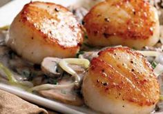 Sautéed mushrooms and leeks have a robust flavor that marries nicely with a touch of brandy and sour cream in this quick scallop dish. Substitute vermouth fo...