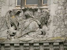 Incredible architectural detail...knight, dragon & lion.  Possibly from the family's coat of arms?
