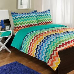 Liven up your bed with the whimsical Exotica Reversible Comforter Set. Decked out in a fun rainbow chevron pattern in yellow, green, red, blue, orange and aqua, the vibrant bedding brings a bright and bold look to any room's décor.
