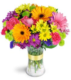 It looks like there's a pot of gold at the end of this rainbow! Wonderfully bright hues are sure to provide the perfect pick-me-up. Daisies, alstroemeria, carnations, and more represent every shade of the rainbow in this delightful bouquet.