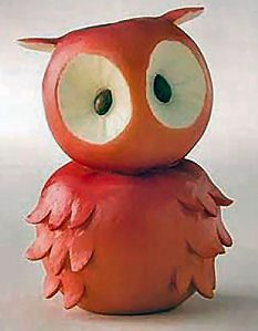 Animal figurines made out of fruit and vegetables from Home Grown Foods. This is an owl carved out of a red apple!