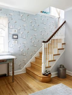 Very cool pale blue bird wallpaper in entryway on older home // At Home with Michelle Gage