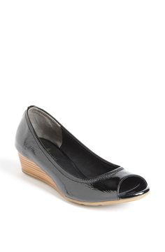 I own these shoes. Cole Haan black patent peep toe