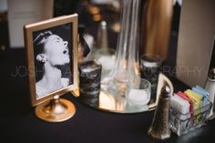 Photos of famed artists from the Harlem Renaissance time period were on each table..