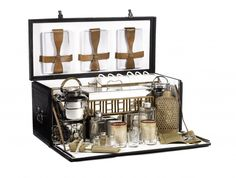 A fine and impressive six-person 'En Route' picnic set by Drew & Sons, London, circa 1911 28 inches wide