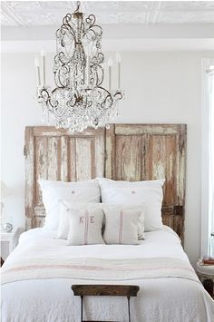 rustic headboard with gorgeous chandelier
