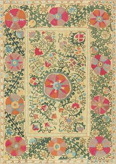 Antique Uzbek Suzani late C 19 - a beautiful design of abstract, pinwheel-style blossoms and spiraling vines. A composition made of equal parts soft yellows, greens and daring reds, blues, oranges and browns...