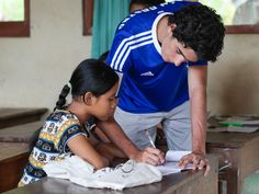 Our volunteer Eduardo is checking the answers of his student from the Letter Game