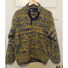 Vintage Patagonia snap-t fleece pullover Patagonia snap-t pullover with pockets from the 80s! Has pockets which is rare for the synchilla fleece. Yellow and blue with purple snaps, excellent condition, fleece has been washed and worn so not as soft as new ones but still super cozy and warm. No defects, would fit a men's small-medium, or women's small-medium-large depending on how oversized you want it! Patagonia Tops Sweatshirts & Hoodies