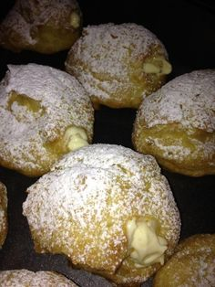 - Cream Puffs -  Filling: 8 oz cream cheese Instant Vanilla Pudding (large box)  1c heavy cream 1.5c milk  Mix cc in bowl w/ mixer until smooth+creamy. Add vp+milk & mix on low until incorp. Then mix on med until thick.   Donut: 1c H20 1c butter  2c flour  5 eggs  Medium heat, melt butter in H20. Bring to boil + remove from heat. Quickly whip in flour w/ a wooden spoon. Add 1 egg @ a time. Drop by cookie scoop onto parch paper    Bake: 350 - 30 min.   Cool, fill, & dust w/ powder sugar.