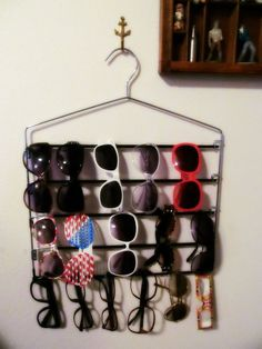 How to store your sunglasses with a pants hanger.