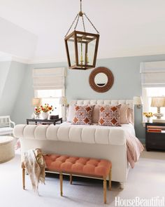 To add punch to the master bedroom of an Old Greenwich, Connecticut, house, designer Lee Ann Thornton upholstered a bench in an orange linen, Tuska/19 from Malabar. The John Robshaw print on the throw pillows reinforces the orange theme. The bed is upholstered in Stella Sand from Lulu DK. Lantern and nightstands from Mecox Gardens.