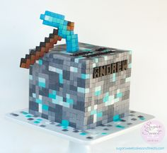 """Diamond Ore Minecraft Cake - Minecraft cake for my son's 10th birthday. He asked for the Diamond Ore Cube with Diamond Pick Axe. Boy was this time consuming, tile by tile, panel by panel. Plus, he had to tell me that each panel matched one another and as OCD as I am, I had to also make the corner pieces match up. Used a Minecraft font for his name (he loved the Creeper Character in the """"A""""). 8x8x8 inch cube cake."""
