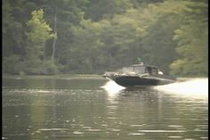 Low profile fast moving craft with shallow draft launches assualt during training event.