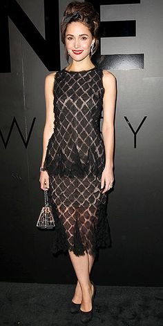 ROSE BYRNE channels a different decade – the '90s – with her bow-adorned updo and slinky sheer dress, accessorized with a drop-handle clutch, Sergio Rossi heels and scarlet lips.