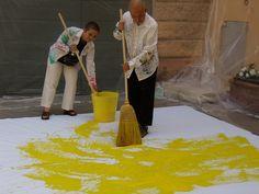 Floor painting with brooms (Shozo Shimamoto performance, Palazzo Magnani, Reggio Emilia)