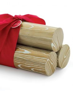 Yule Log Gift Packaging-Here's an attractive way to package unusually shaped gifts, such as glassware or bottles: Put them in mailing tubes dressed up as Yule logs.
