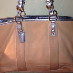 ‼️70%OFF RETAIL‼️COACH TOTE Beautiful Coach canvas tote with metallic blue straps coach creed and coach tag. Beautiful tote. Priced accordingly due to slight wear on strap ONLY. Still great condition, no stains! Very clean!  Coach Bags Totes
