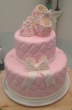 baby shower cake with cute little baby shoes