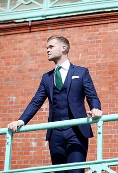 The fit of this navy blue suit is excellent and the look was put together perfectly!