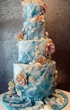 Big Wedding cake with an ocean theme. Cake is decorated in buttercream and all shells are white chocolate. Really makes you want to dive in :) Elin Big Wedding Cakes, Beautiful Wedding Cakes, Beautiful Cakes, Sea Wedding Theme, Amazing Cakes, Camo Wedding, Hawaii Wedding Cake, Wedding Tuxedos, Seaside Wedding