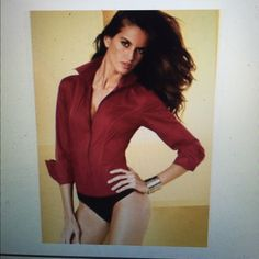 Victoria's Secret seamed bodysuit Brand new never worn. Great with skirts or pants. Comes with extra buttons Moda International Tops Button Down Shirts