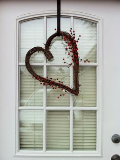 My Valentine's Day wreath: My mother-in-law gave me this heart-shaped grapevine wreath, so I added some red Christmas berry picks from Hobby Lobby. Simple, but sweet.
