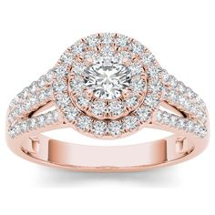 On the day you ask for her hand, wow her with this bridal ring set crafted in rose gold. Featuring a solitaire center stone, it is surrounded by double frame of accent diamonds atop a diamond-lined shank while two diamond bands complete the romantic look.