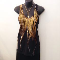 A terrific BARBARA BUI tank top!   The champagne and gold design draws all the attention to you! Cotton.  Size small.  Please call 949-715-0004 for inquiries.
