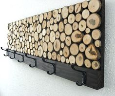 Just gave me an idea. Definitely wouldn't use all those wood pieces in there, but just take a rectangular piece of wood, add a thin piece along bottom, add hooks onto that (just like pictured) bit make the large part a chalkboard and maybe even add another strip of wood along the top for a shelf...Liking this...