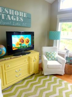 Smart: Offset the TV on a Long Piece of Furniture - The Happy Housie via House of Turquoise