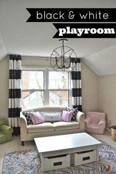 A graphic black and white playroom with lots of fun accessories