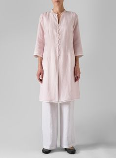 3/4 sleeve tunic- mid thigh- second layer of contrasting fabric.